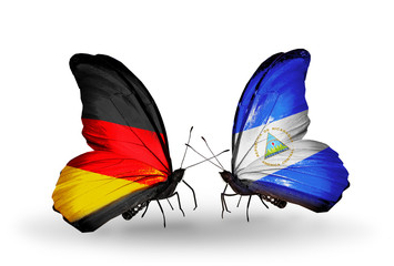 Two butterflies with flags Germany and Nicaragua