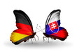 Two butterflies with flags Germany and Slovakia