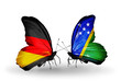 Two butterflies with flags Germany and Solomon Islands
