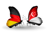 Two butterflies with flags Germany and Singapore