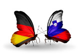 Two butterflies with flags Germany and Slovenia