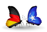Two butterflies with flags Germany and Somalia