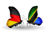 Two butterflies with flags Germany and Tanzania