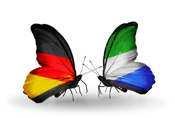 Two butterflies with flags  Germany and Sierra Leone