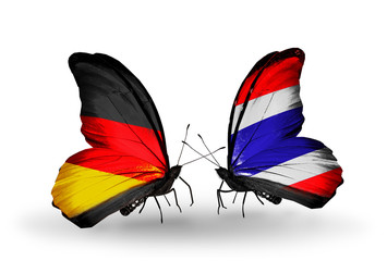 Two butterflies with flags Germany and Thailand