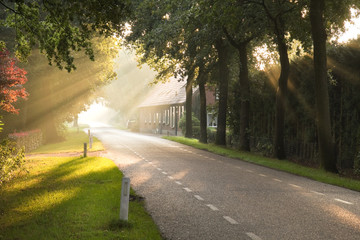 Dutch country road and farm with sun beams