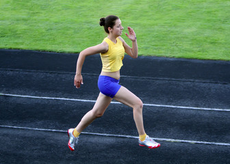 Girl running on the stadium track