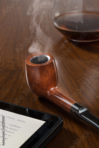 Pipe with smoke and tablet