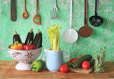 various vegetables and vintage kitchen utensils