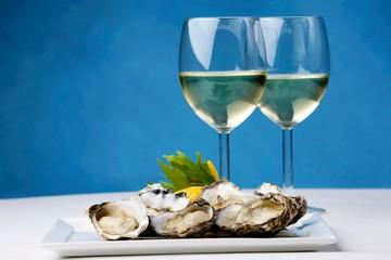 Ostriche e Vino Bianco
