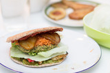 Delicious vegan burger on white plate