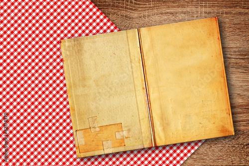 Old recipe book on kitchen table