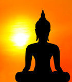 Buddha statue in the sunset background