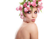 Portrait of a beautiful spring girl wearing flowers hat. Studio