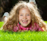 Laughing girl on grass