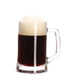 Tall big mug of brown beer with foam.