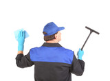 Worker in gloves with window cleaner.