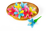 Colored paper flowers in the basket and one flower near it