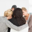 Women hugging in rehab group