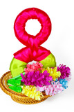 Colored paper flowers in the basket with symbol from 8 of March