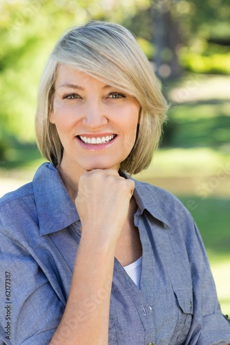 Woman with hand on chin in park