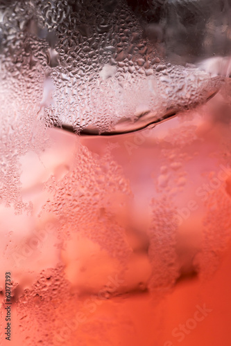 Carbonated Bubbles Rising in a Red/ Pink Liquid