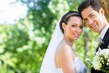 Loving bride and groom in garden