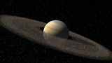 Saturn like planet with spinning asteroid rings
