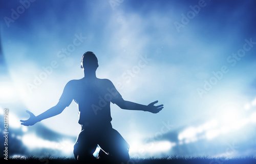canvas print picture Football, soccer match. A player celebrating goal, victory