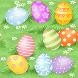 Multi-colored Easter eggs hidden in green grass seamless backgro