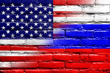 USA and Russia Flag painted on brick wall