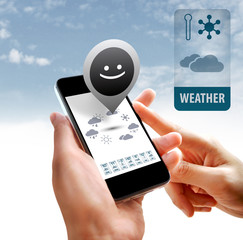 Hands holding smartphone with weather widget