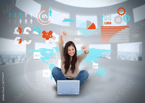 Cheering girl using laptop with interface