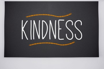 Kindness written on big blackboard