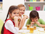 Kids chomping on sandwiches