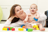Happy mother and toddler child playing