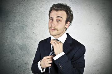 Businessman fixes his tie