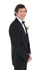 Handsome groom in tuxedo smiling