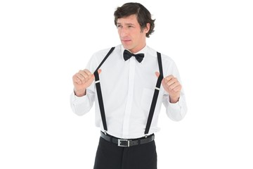 Thoughtful man stretching suspenders