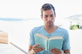 Concentrated man reading book