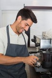 Waiter preparing espresso at coffee shop