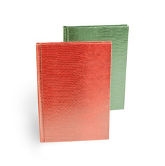 red and green books in leather cover on a white background, Snak