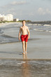 teenager enjoys jogging along the beach