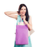 Pretty happy young woman holding shopping bags