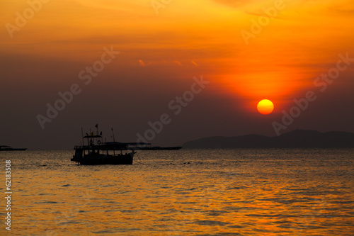 Fishing boat   in Thailand. Silhouette of Fishing Boat on Sunris
