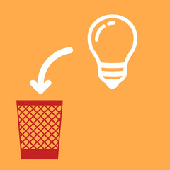 wastebasket and a light bulb