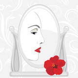 Female face in mirror