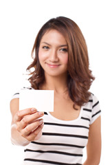 smiling, happy, positive woman showing blank business card