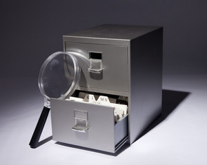 Filing Cabinet and Magnifying Glass