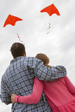 Man & Woman Couple Flying Red Kites